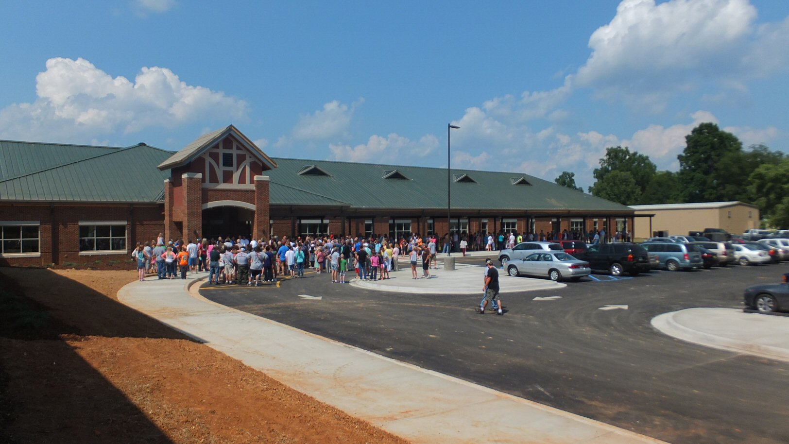 Inauguration of the new Madison County Middle School August 03 2014 with Lindsey Schneider teacher at Lincoln Academy and Vinvent Shneider MBA Graduate of Montevallo University and Gurley Lions Club Member